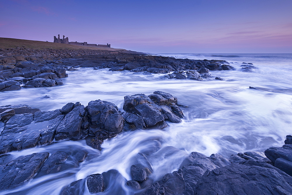 Dunstanburgh Castle at dawn, Craster, Northumberland, England, United Kingdom, Europe - 799-3661