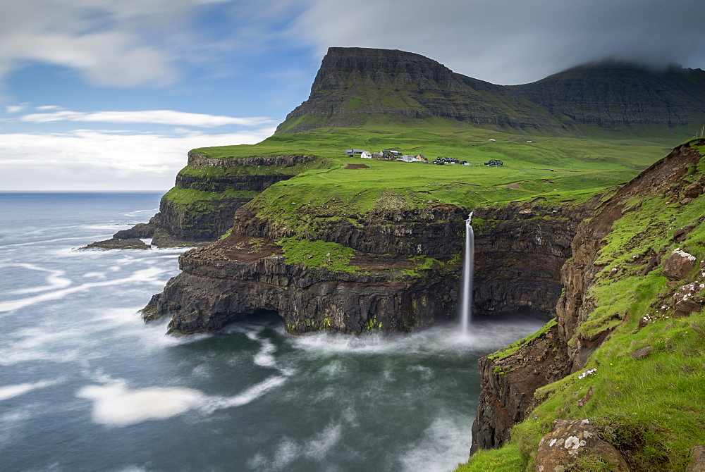 Waterfall cascading over cliffs at Gasadalur in the Faroe Islands, Denmark, Europe - 799-3664