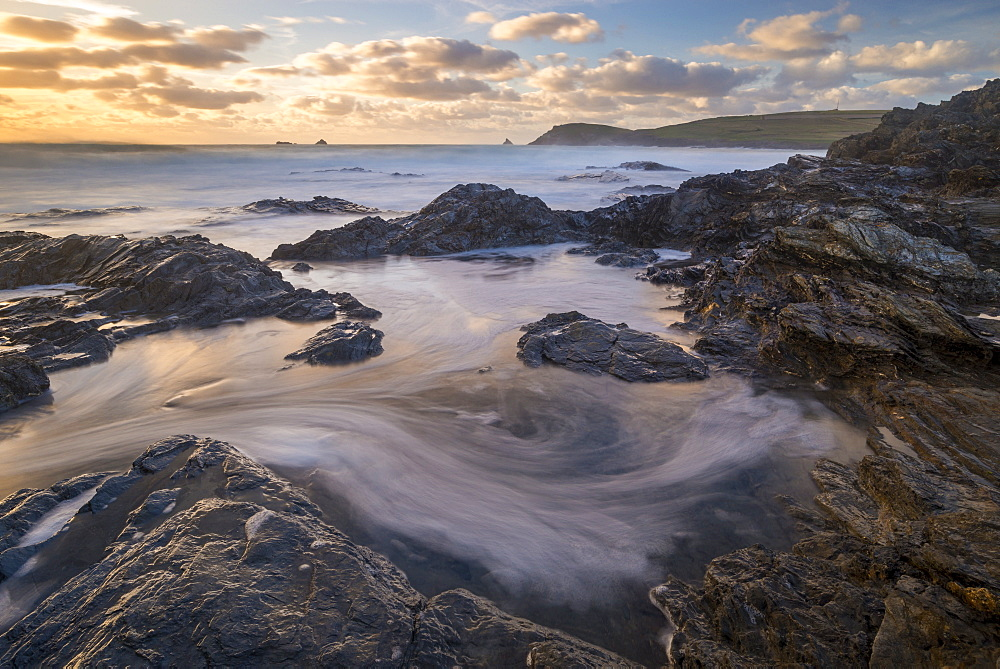 Swirling waves on the rocky shores of Booby's Bay near Trevose Head at sunset, Cornwall, England, United Kingdom, Europe - 799-3673