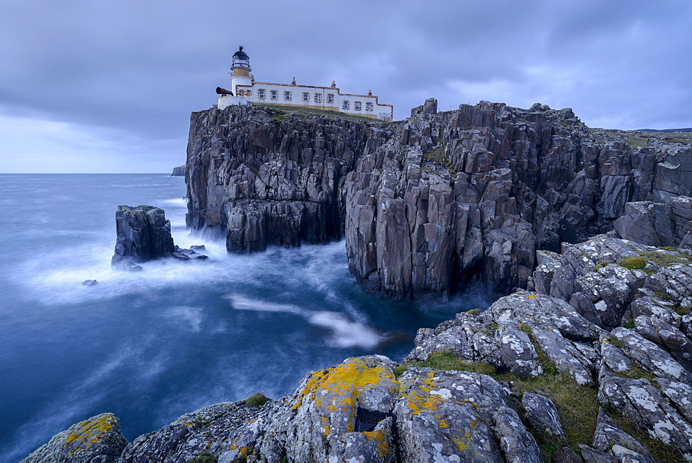 Neist Point lighthouse, perched on dramatic cliff tops on the west coast of the Isle of Skye, Inner Hebrides, Scotland, United Kingdom, Europe - 799-3680