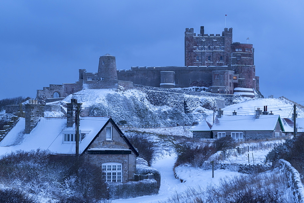 Bamburgh village and Castle in deep winter snow, Northumberland, England, United Kingdom, Europe - 799-3697