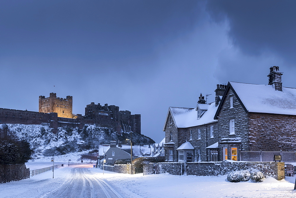 Bamburgh Castle and village in winter snow, Northumberland, England, United Kingdom, Europe - 799-3698