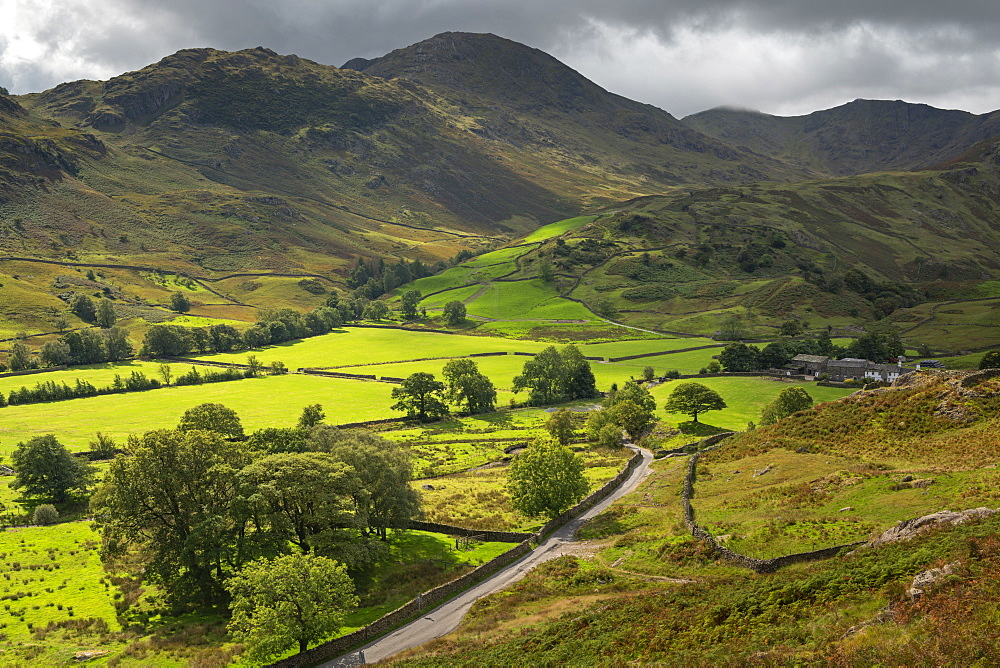 Rolling farmland and mountains in Little Langdale, Lake District National Park, Cumbria, England. Autumn (September) 2018.