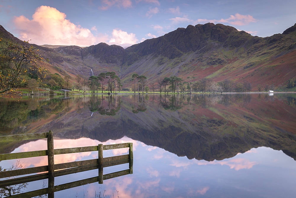Perfectly still Lake Buttermere at sunset, Lake District National Park, Cumbria, England. Autumn (October) 2018.