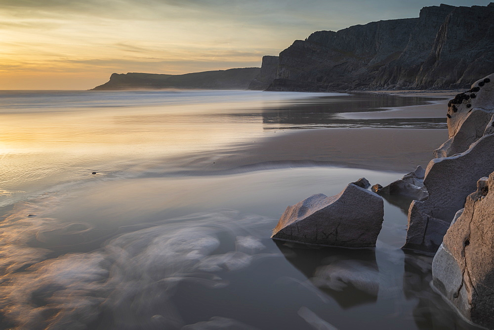 Sunset over a deserted Mewslade Bay in Gower in winter, South Wales, United Kingdom, Europe