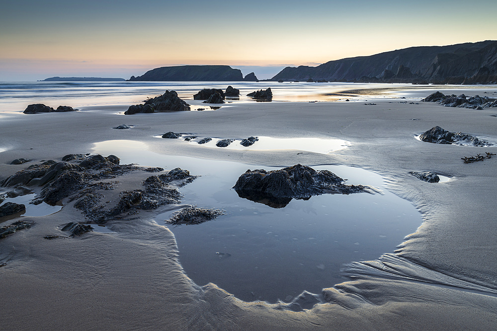 Tidal pools on Marloes Sands beach at twilight, Pembrokeshire Coast National Park, Wales, United Kingdom, Europe