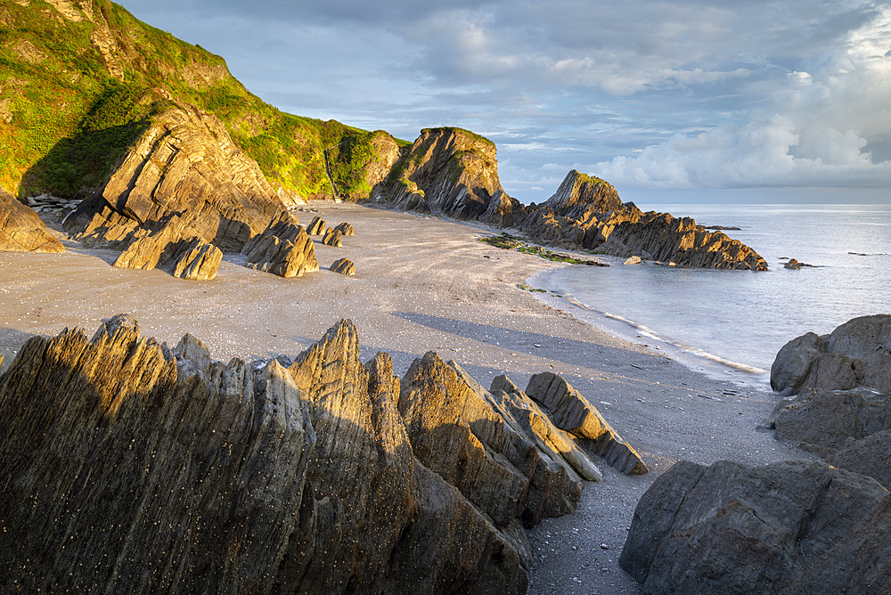 Deserted beach at Lee Bay, North Devon, England. Summer (June) 2019.