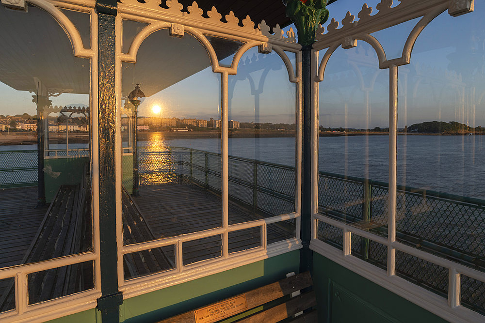 Sunset reflected in the glass shelters on Clevedon Pier, Cleveon, Somerset, England. Summer (July) 2019. - 799-3836
