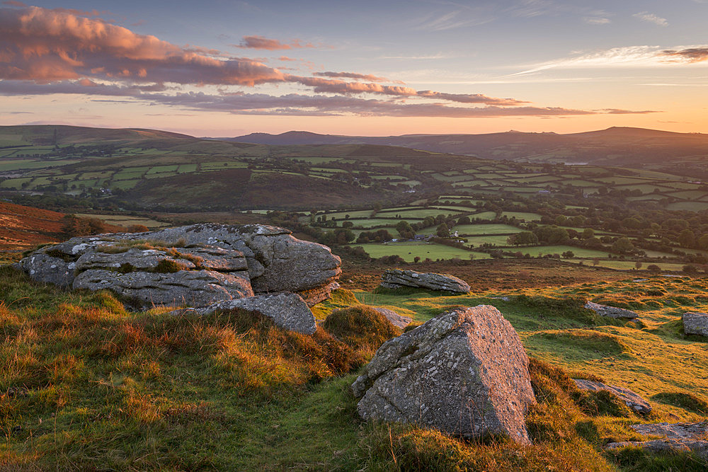 Sunrise over rolling countryside from Corndon Tor, Dartmoor, Devon, England. Autumn (October) 2016.