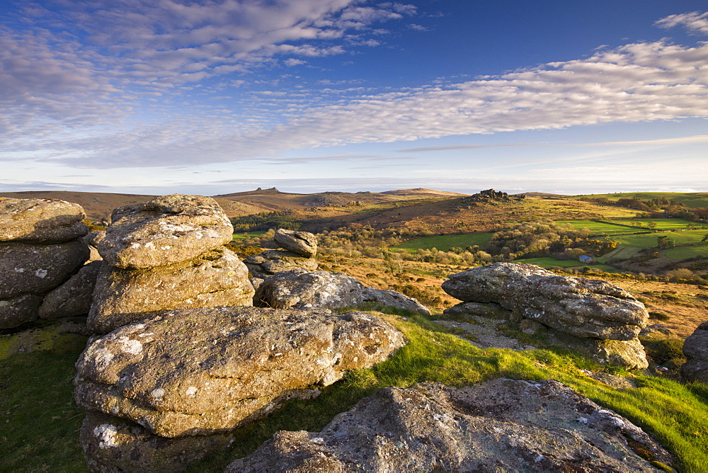 Granite outcrop at Hayne Down, looking over moorland towards Hound Tor and Haytor, Dartmoor National Park, Devon, England, United Kingdom, Europe