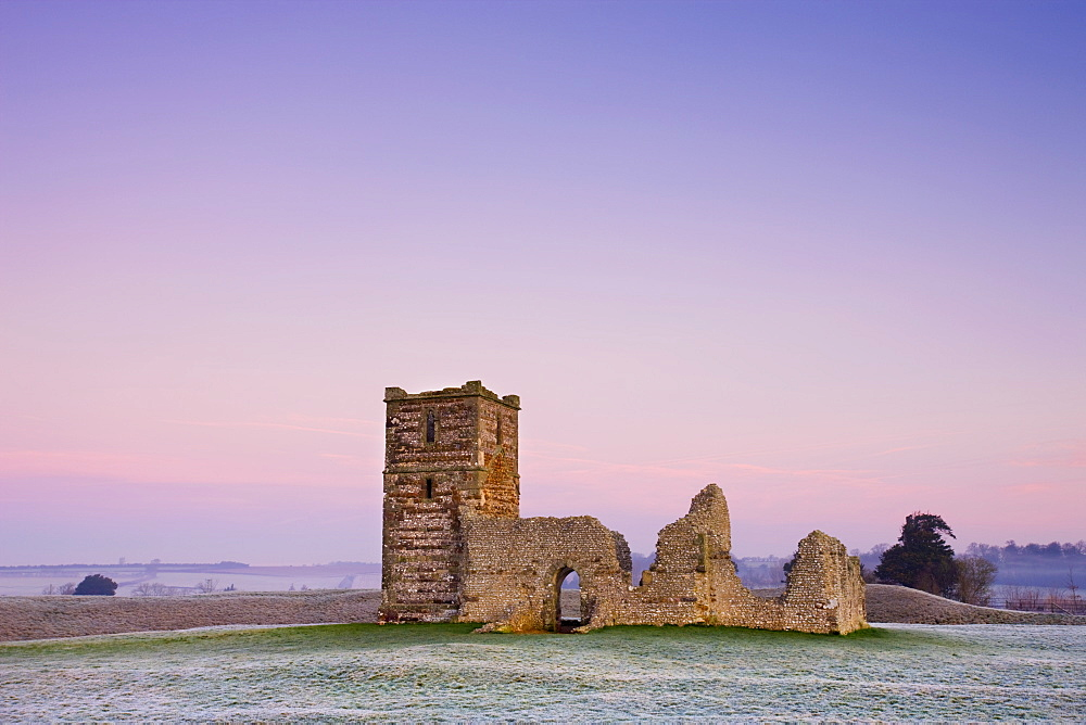 Ruins of Knowlton Church beneath pastel pink skies on a frosty winter morning, Knowlton, Dorset, England, United Kingdom, Europe