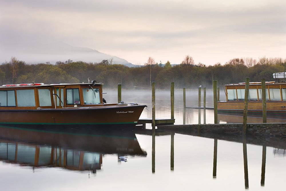 Lakeland Mist boat moored on Derwent Water on a misty autumn morning, Keswick, Lake District National Park, Cumbria, England, United Kingdom, Europe