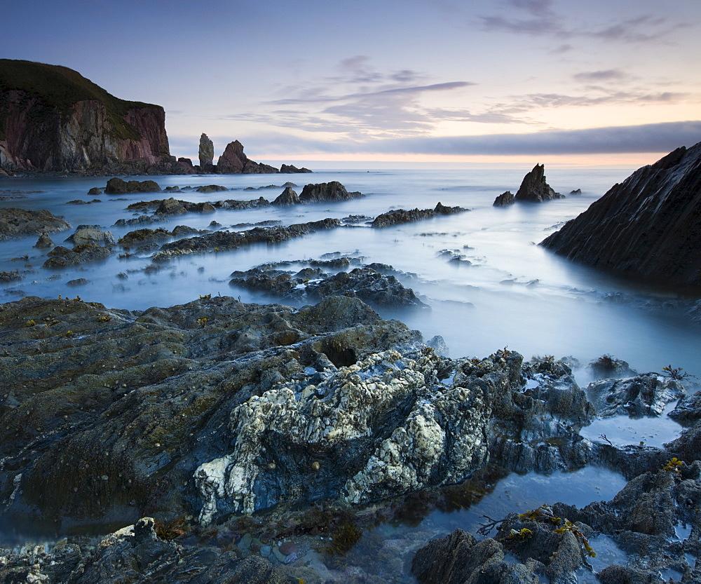 Rocky shores of Bantham at twilight, South Hams, Devon, England, United Kingdom, Europe