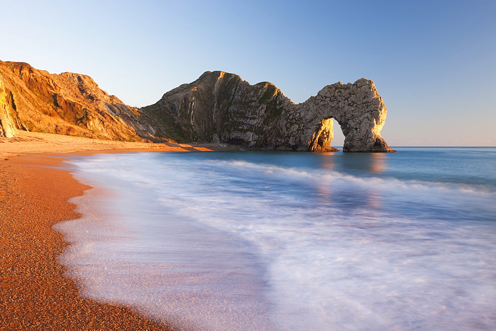 Durdle Door beach on a gorgeous sunny evening, Jurassic Coast, UNESCO World Heritage Site, Dorset, England, United Kingdom, Europe