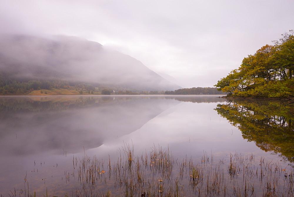 Autumn scene beside a misty dawn at Loch Voil in the Balquhidder Valley, Loch Lomond and the Trossachs National Park, Perthshire, Scotland, United Kingdom, Europe - 799-821