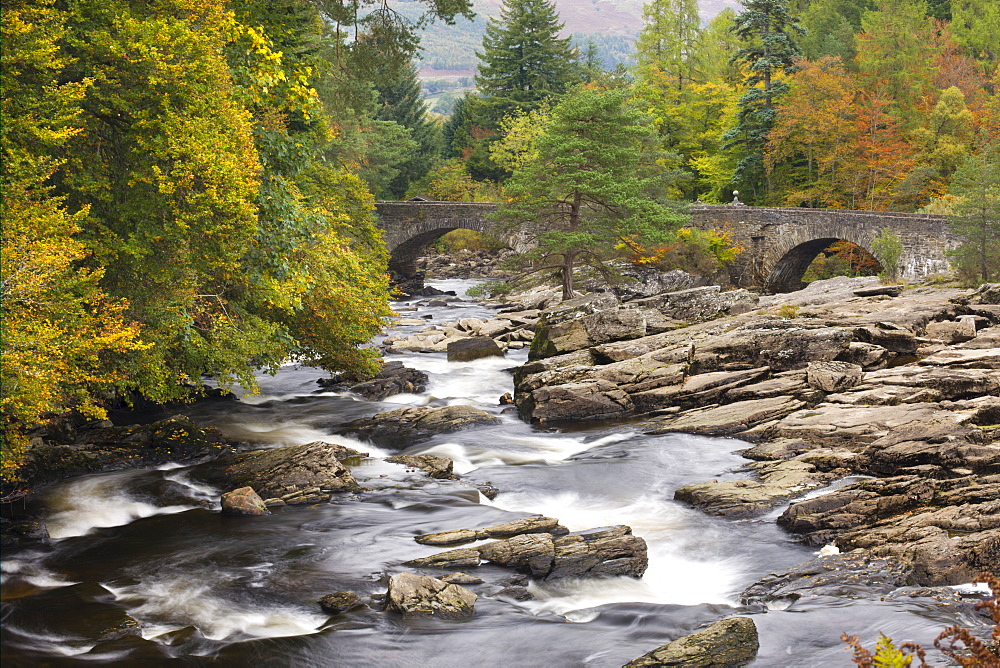 The Falls of Dochart and stone bridge surrounded by autumn foliage at Killin, Loch Lomond and The Trossachs National Park, Stirling, Scotland, United Kingdom, Europe - 799-825
