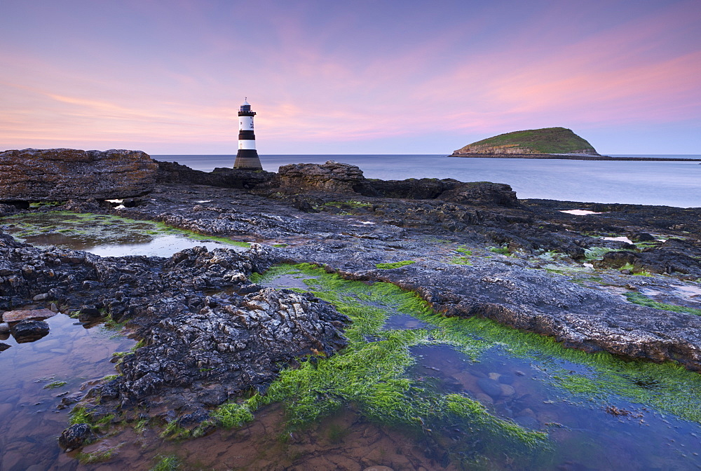 Dusk over Penmon Point Lighthouse and Puffin Island, Isle of Anglesey, Wales, United Kingdom, Europe