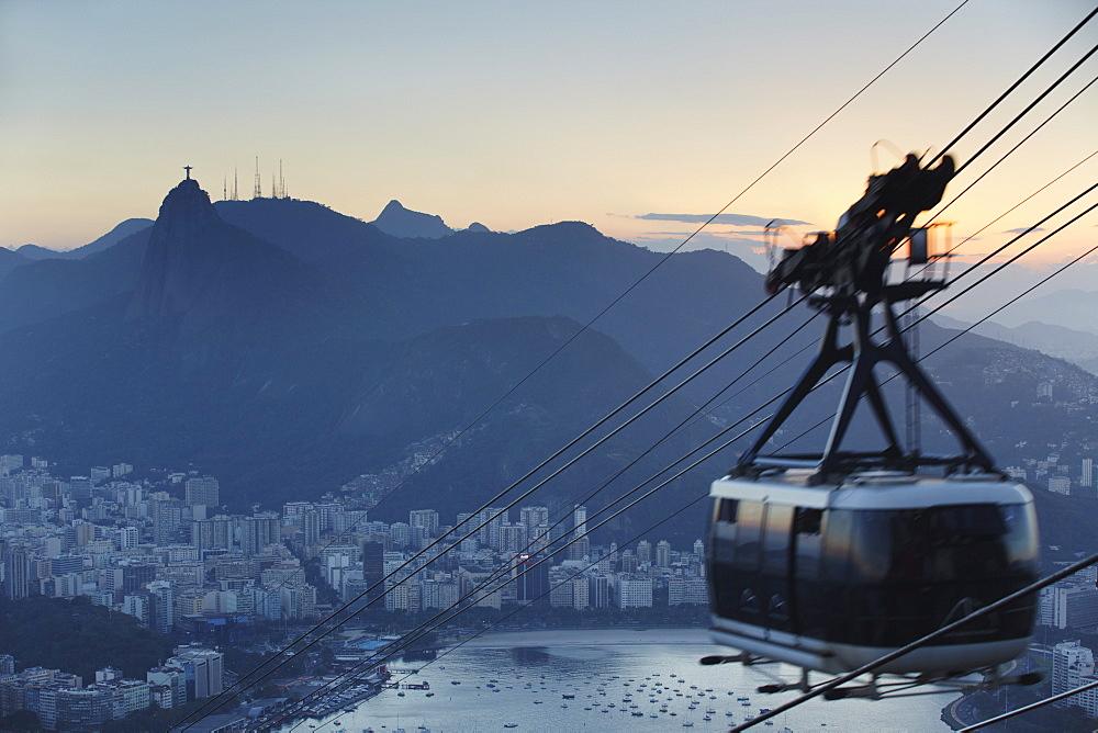 Cable car descending from Sugar Loaf Mountain (Pao de Acucar), Rio de Janeiro, Brazil, South America
