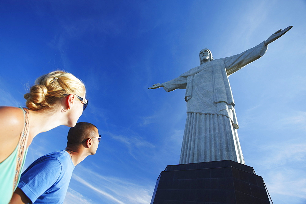 Couple at Christ the Redeemer statue (Cristo Redentor), Corcovado, Rio de Janeiro, Brazil, South America  - 800-1269