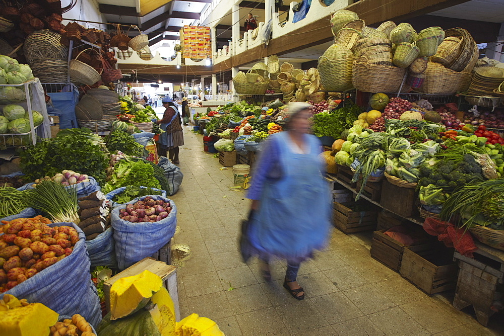Woman walking through market, Sucre, UNESCO World Heritage Site, Bolivia, South America