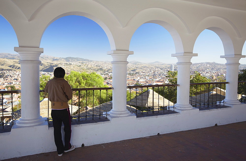 Woman enjoying view from Plaza Anzures, Sucre, UNESCO World Heritage Site, Bolivia, South America