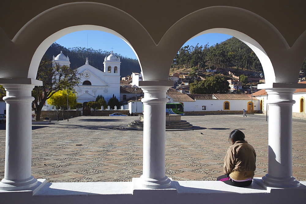 Woman sitting in Plaza Anzures, Sucre, UNESCO World Heritage Site, Bolivia, South America