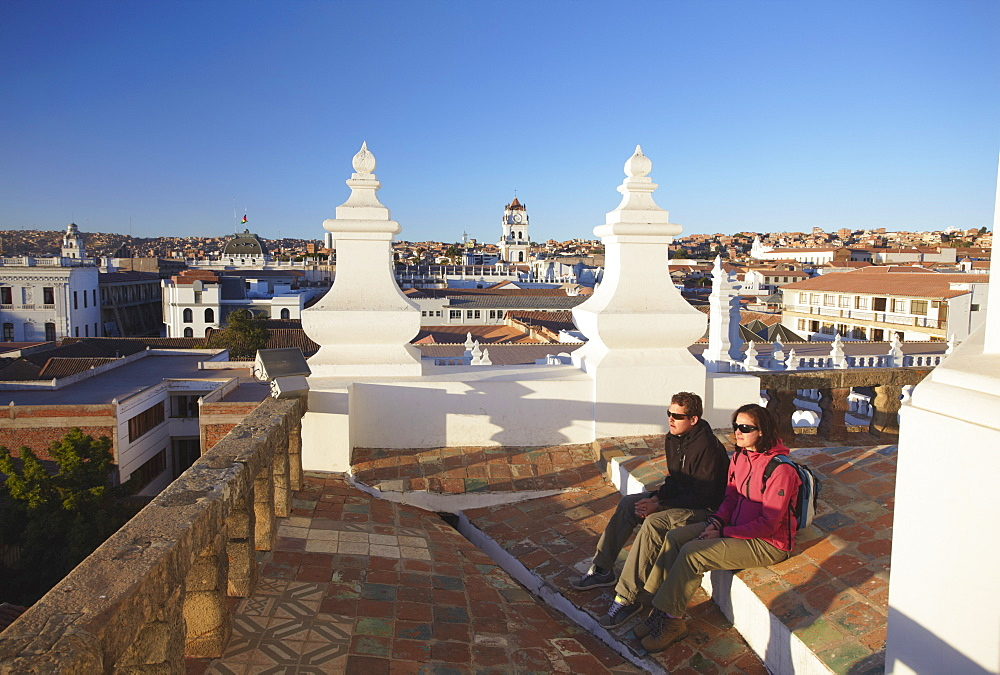 Couple sitting on rooftop of Convento de San Felipe Neri, Sucre, UNESCO World Heritage Site, Bolivia, South America