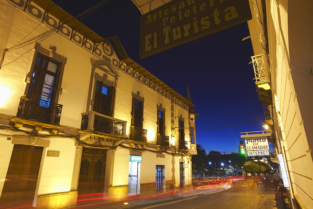 Traffic passing along street at dusk, Sucre, UNESCO World Heritage Site, Bolivia, South America