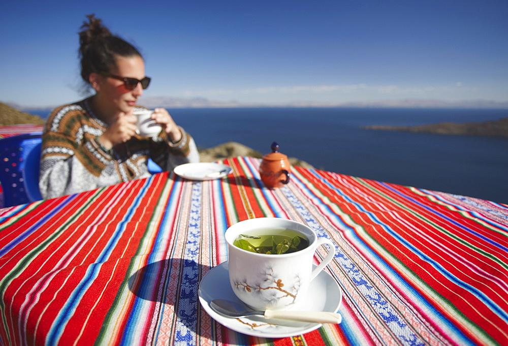 Cocoa leaf tea at outdoor cafe on Isla del Sol (Island of the Sun), Lake Titicaca, Bolivia, South America