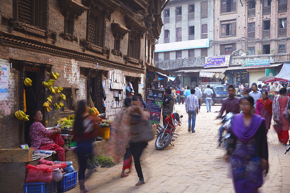 People walking along street, Bhaktapur, UNESCO World Heritage Site, Kathmandu Valley, Nepal, Asia