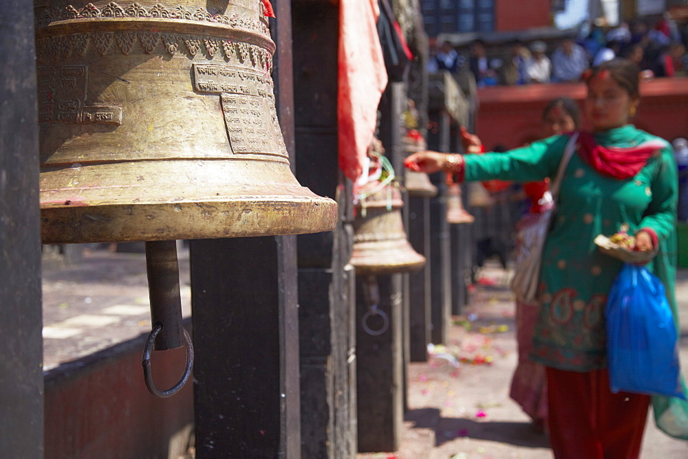 Woman ringing bell, Manakamana Temple, Manakamana, Gorkha District, Gandaki, Nepal, Asia