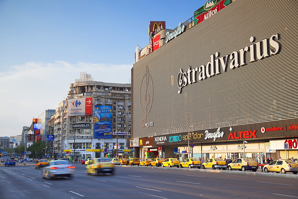 Traffic passing Unirea shopping mall, Bucharest, Romania, Europe