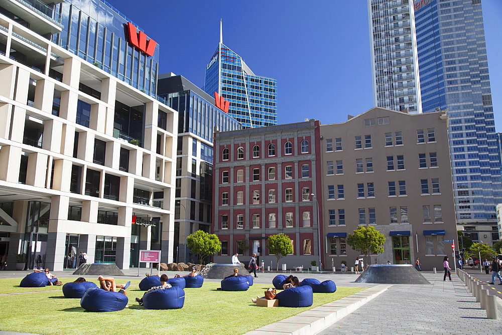 People sitting outside Westpac building in Takutai Square in Britomart precinct, Auckland, North Island, New Zealand, Pacific