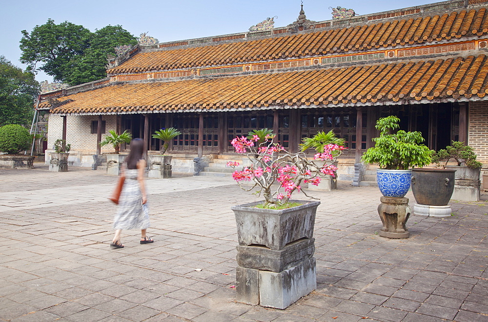 Woman at Hoa Khiem Temple at Tomb of Tu Duc, UNESCO World Heritage Site, Hue, Thua Thien-Hue, Vietnam, Indochina, Southeast Asia, Asia