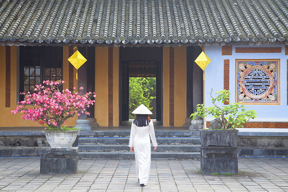 Woman wearing Ao Dai dress at Left House inside Citadel, Hue, Thua Thien-Hue, Vietnam, Indochina, Southeast Asia, Asia