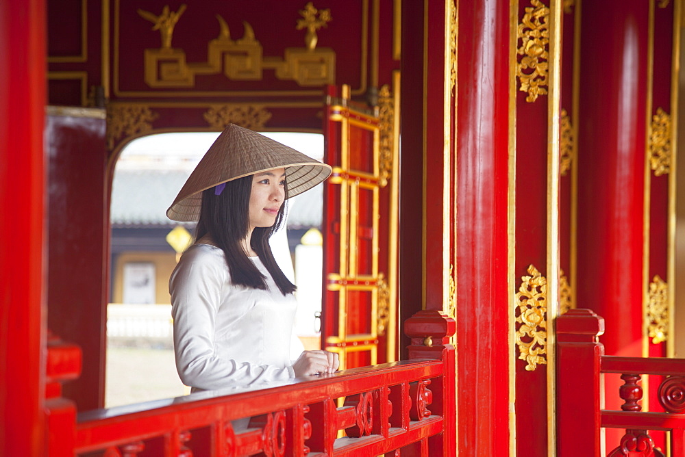 Woman wearing Ao Dai dress in Imperial Palace inside Citadel, Hue, Thua Thien-Hue, Vietnam, Indochina, Southeast Asia, Asia