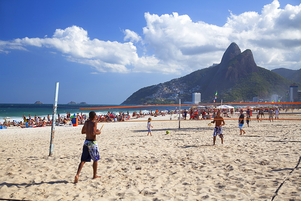 People playing tennis on Ipanema beach at dawn, Rio de Janeiro, Brazil, South America - 800-2237