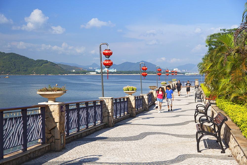 People walking along promenade, Discovery Bay, Lantau, Hong Kong, China, Asia