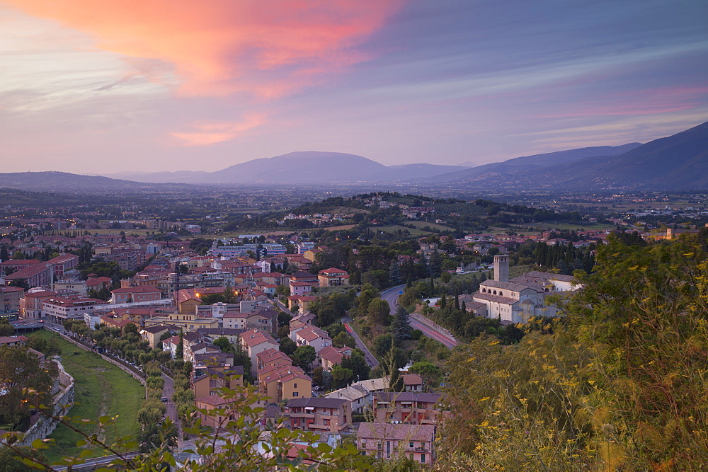 View of Church of St. Ponziano and Spoleto at sunset, Spoleto, Umbria, Italy, Europe