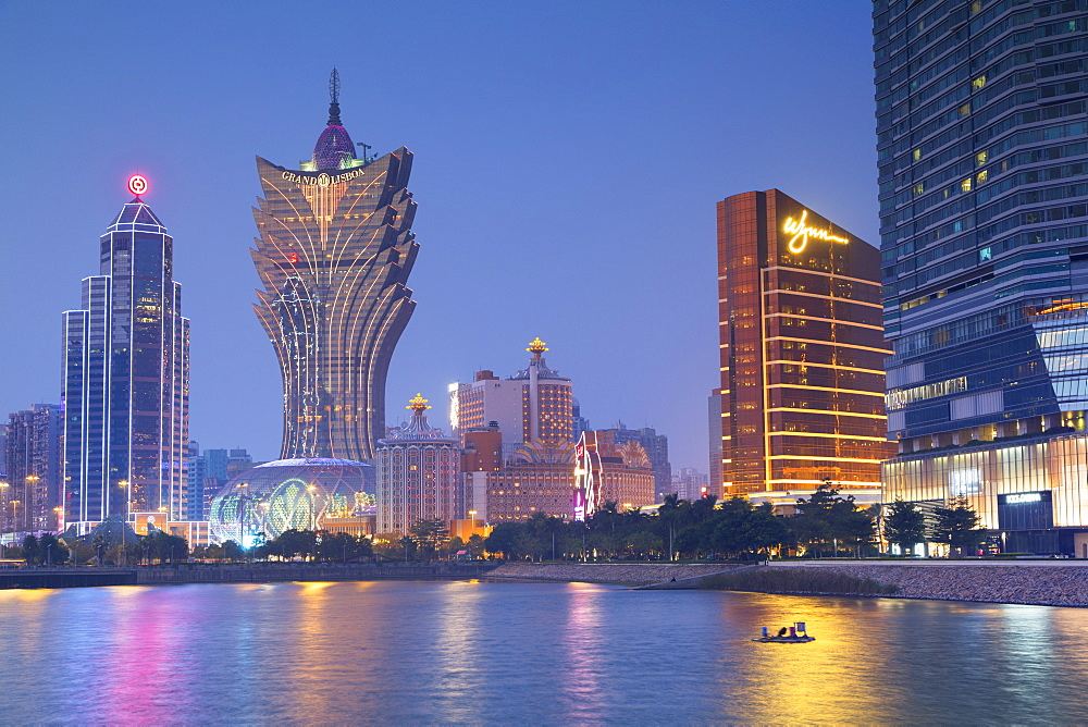 Grand Lisboa and Wynn Hotel and Casino at dusk, Macau, China, Asia