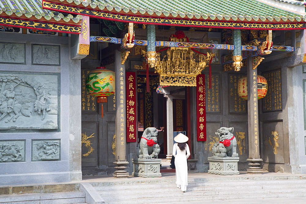 Woman wearing ao dai dress at Nghia An Hoi Quan Pagoda, Cholon, Ho Chi Minh City, Vietnam, Indochina, Southeast Asia, Asia