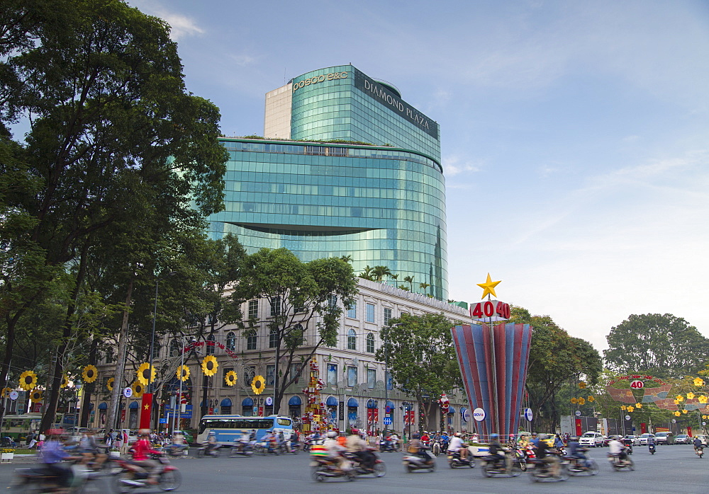 Traffic passing Diamond Plaza, Ho Chi Minh City, Vietnam, Indochina, Southeast Asia, Asia