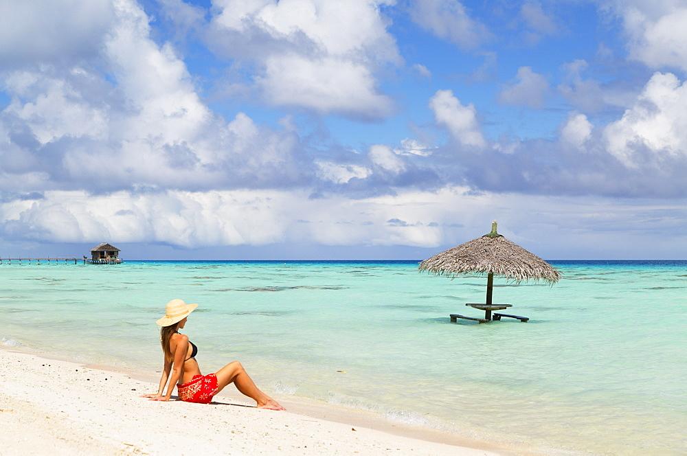 Woman sitting on beach, Fakarava, Tuamotu Islands, French Polynesia, South Pacific, Pacific - 800-2518