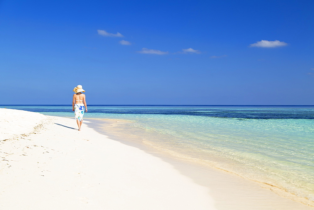 Woman on beach, Rasdhoo Island, Northern Ari Atoll, Maldives, Indian Ocean, Asia