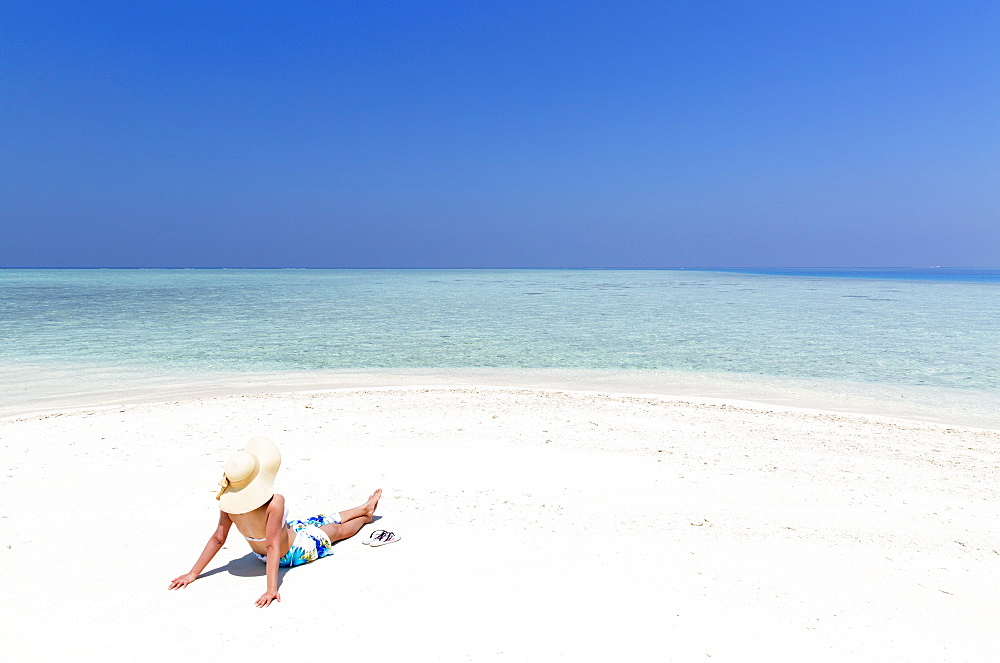 Woman on sandbank, Kaafu Atoll, Maldives, Indian Ocean, Asia