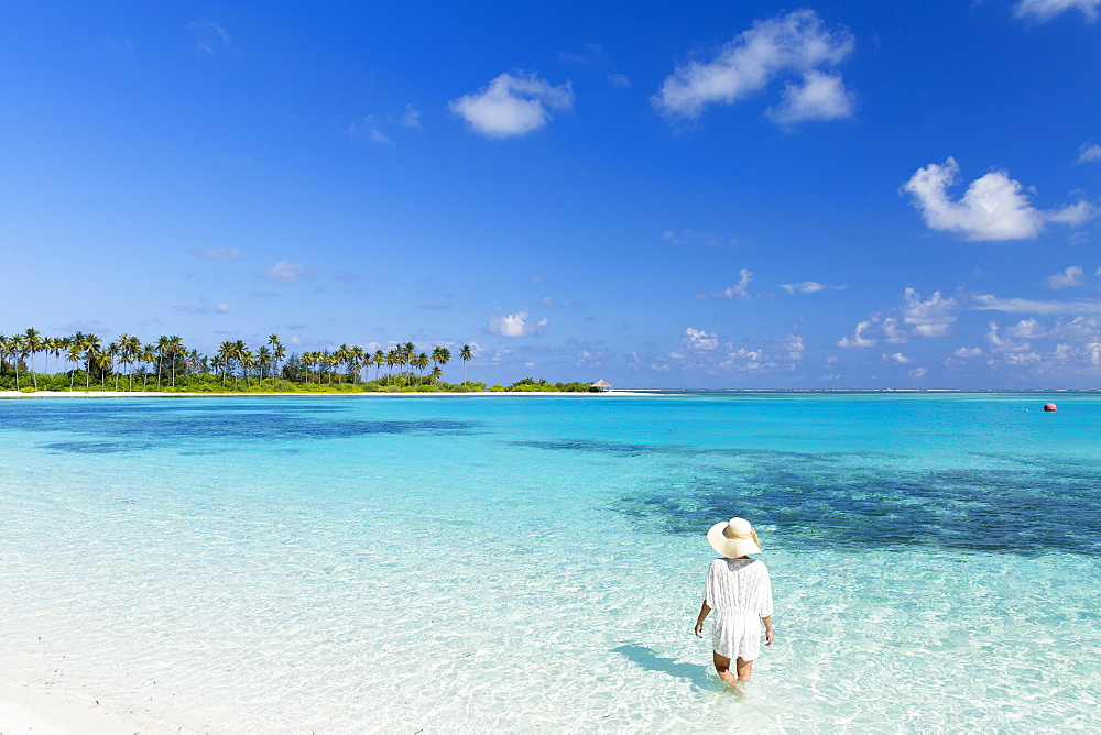 Woman on beach at Olhuveli Beach and Spa Resort, South Male Atoll, Kaafu Atoll, Maldives, Indian Ocean, Asia - 800-2779