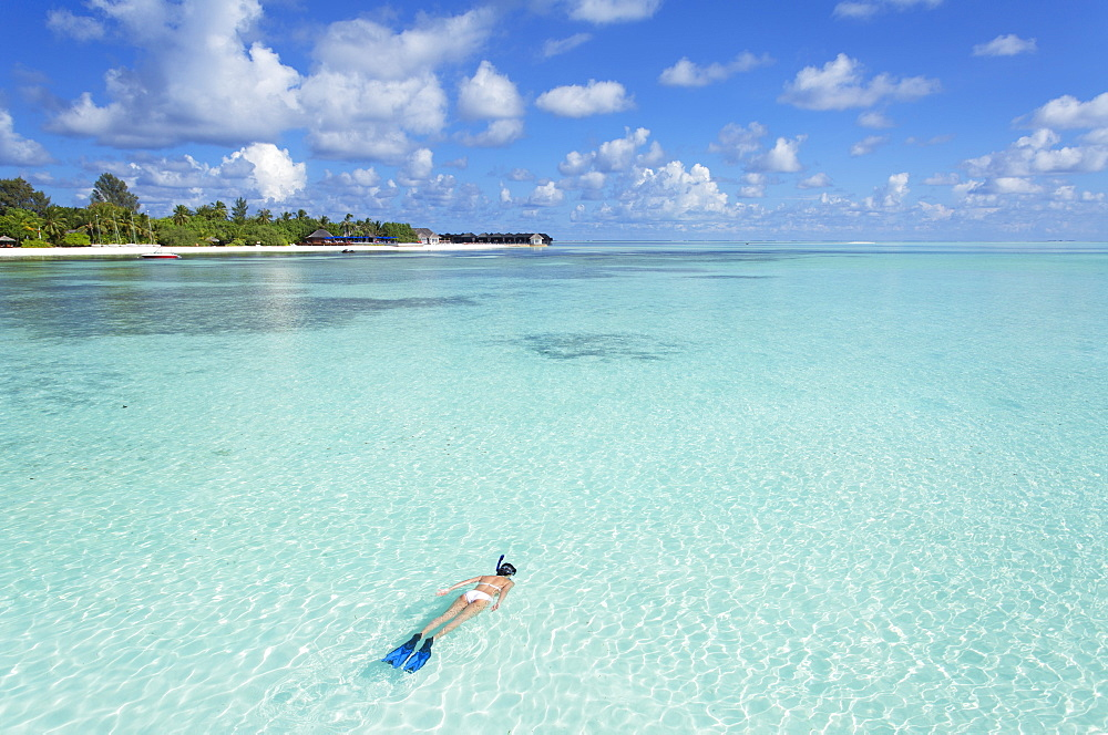 Woman snorkelling at Olhuveli Beach and Spa Resort, South Male Atoll, Kaafu Atoll, Maldives, Indian Ocean, Asia