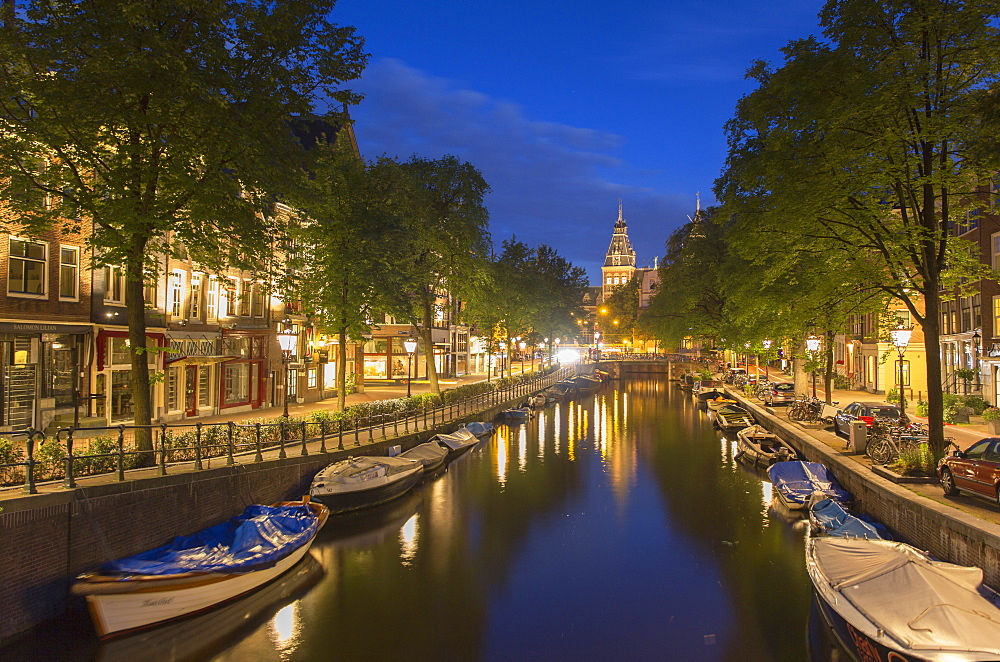 Spiegelgracht canal and Rijksmuseum at dusk, Amsterdam, Netherlands, Europe
