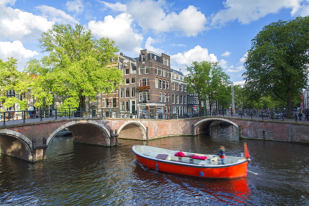 Boat on Prinsengracht canal, Amsterdam, Netherlands, Europe