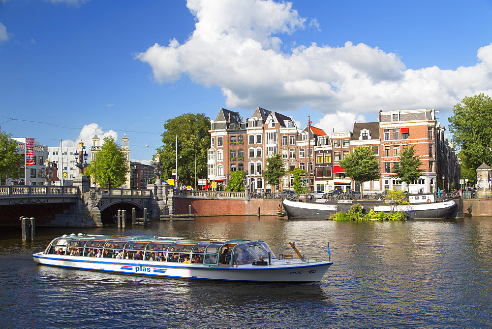 Tourist cruise boat on Amstel River, Amsterdam, Netherlands, Europe